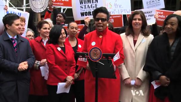 VOA慢速英语: 游行者目的还是希望男女工资待