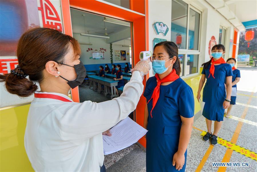 卫健委、教育部:秋季开学后中小学生应随身备用口罩